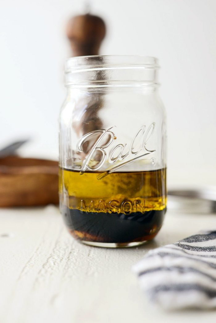 ingredients measured and added into a glass mason jar.