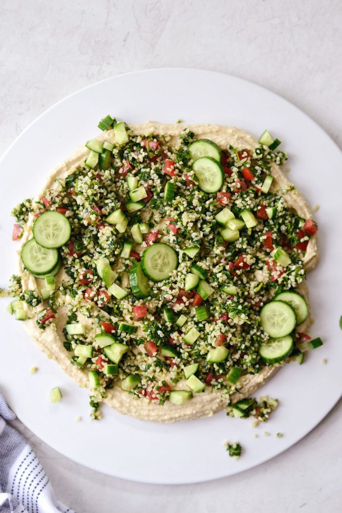 hummus topped with tabbouleh and cucumber