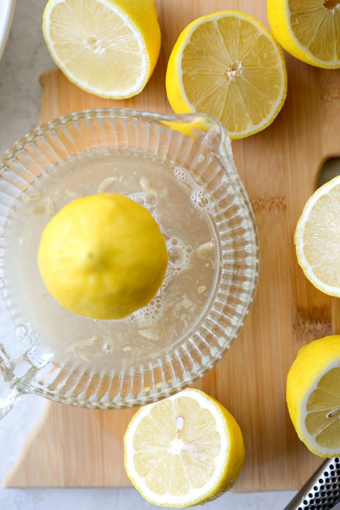 squeezing lemon juice with glass juicer