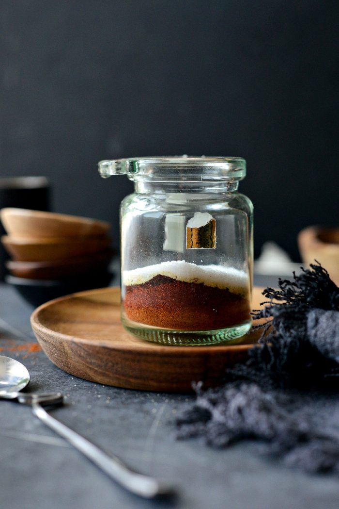 spices added to glass jar