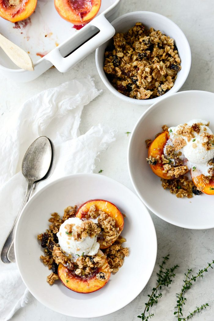 Dishing out Baked Nectarines with Oatmeal Cookie Crumble into white bowls