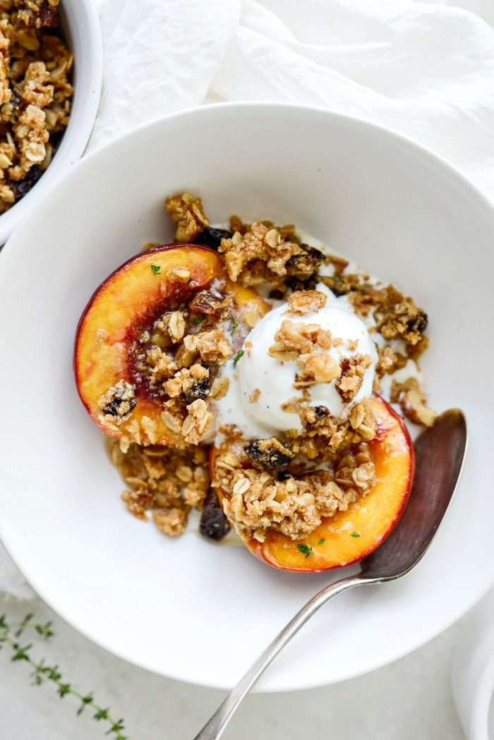 Baked Nectarines with Oatmeal Cookie Crumble in bowl with ice cream