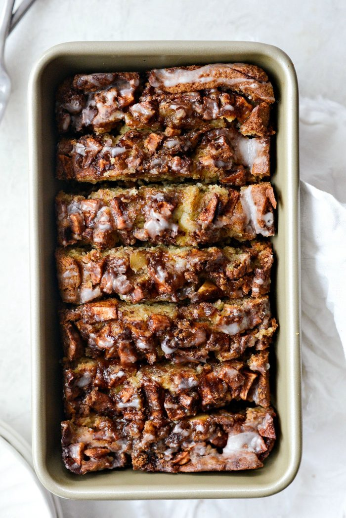 sliced dutch apple fritter bread in gold pan