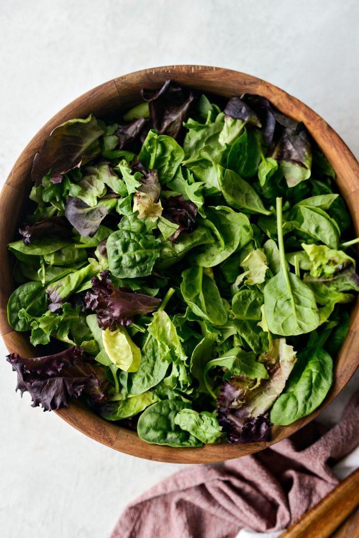 wood salad bowl with mixed salad greens