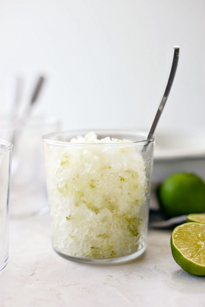 glass of gin and tonic granita with spoon