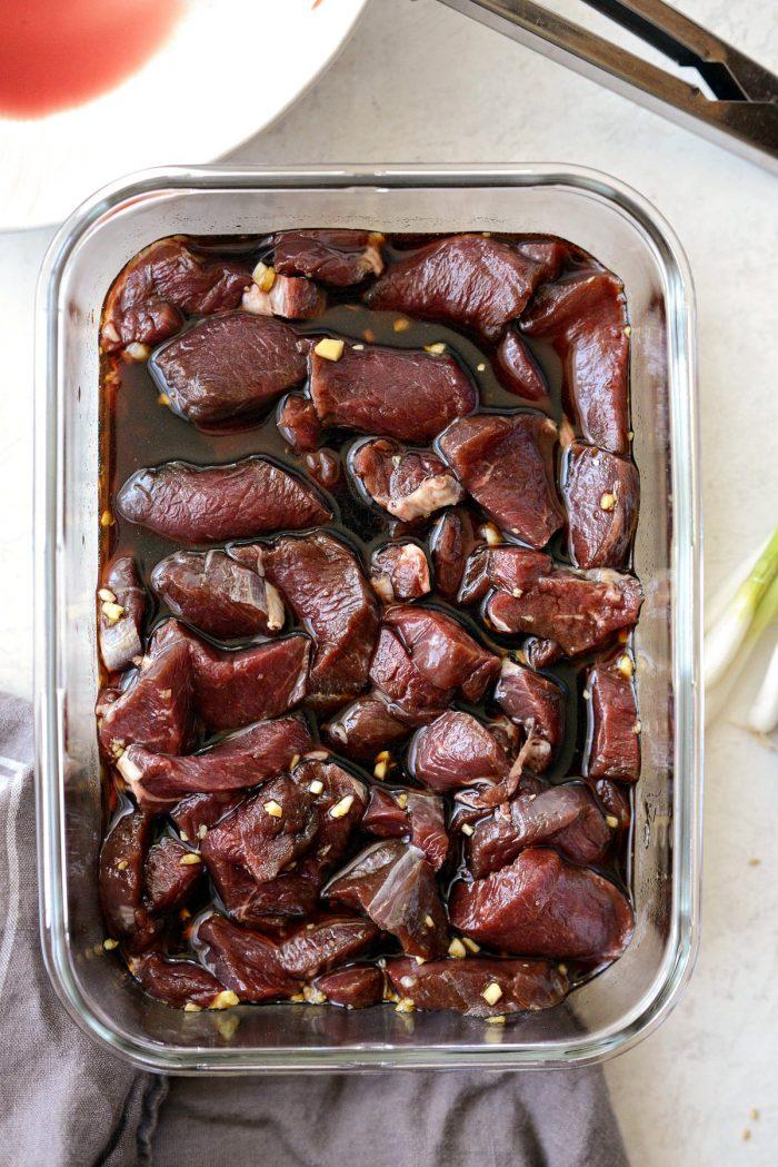 sliced venison backstrap in marinade