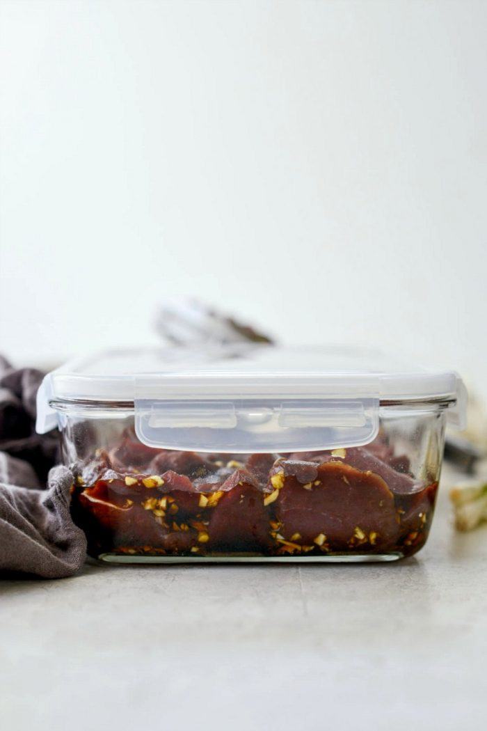 marinade and venison in container with lid