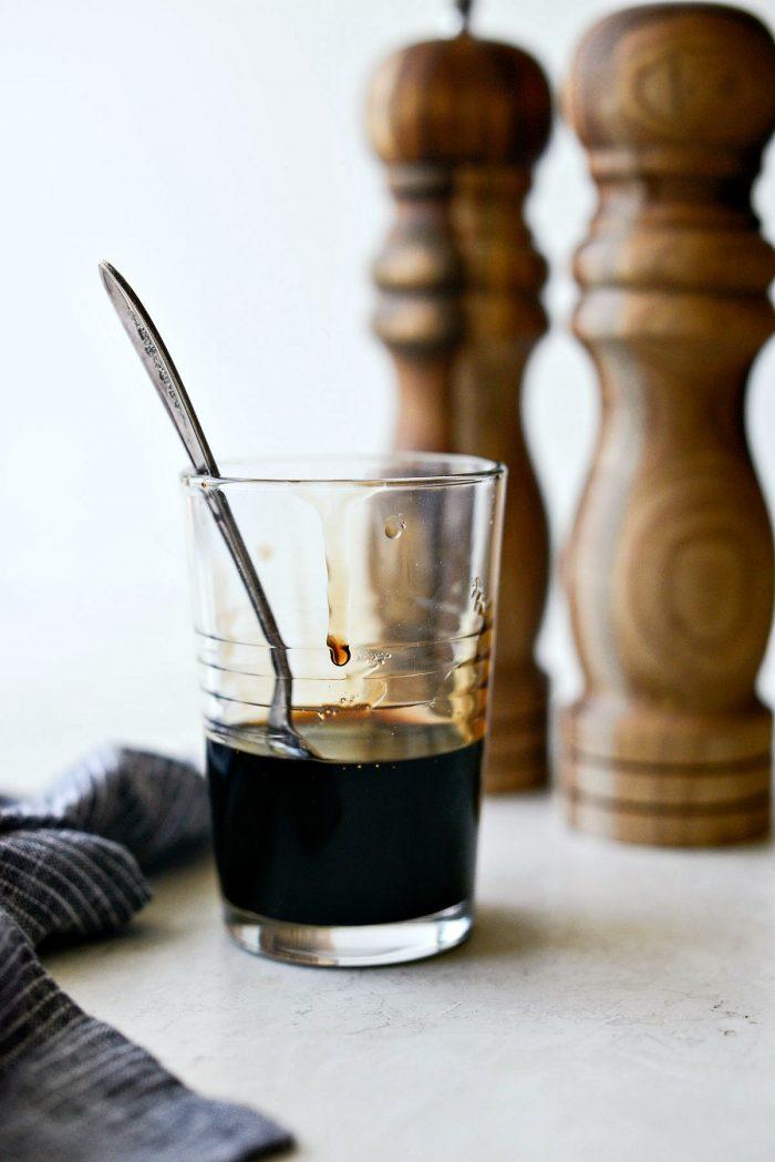 how to make balsamic glaze - glaze in a glass with spoon