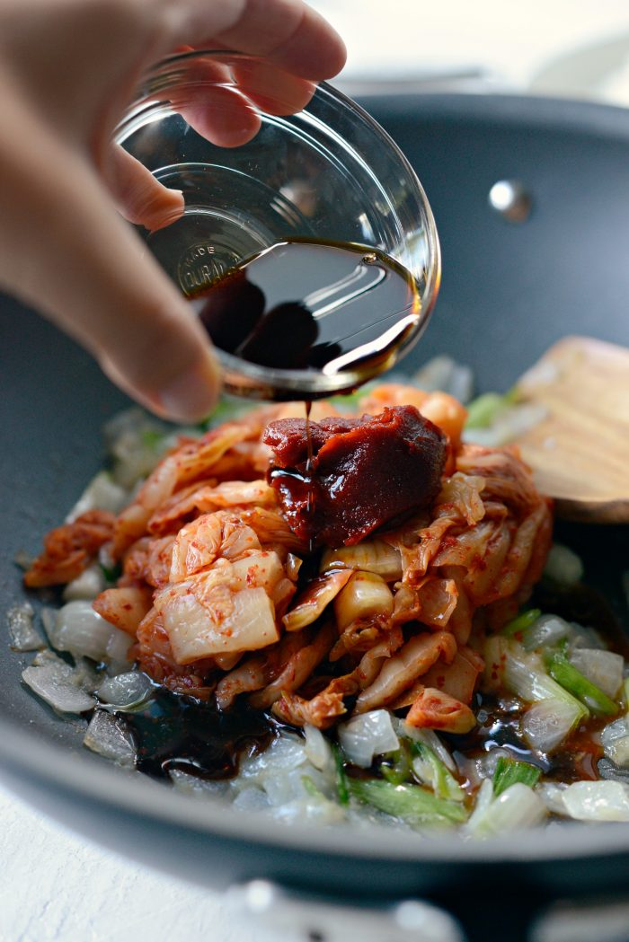 soy sauce, toasted sesame oil, white pepper and gochujang added to wok