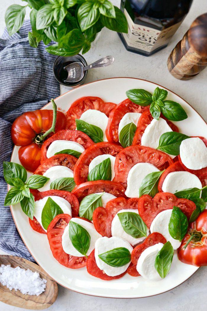 complete platter of tomato, basil and mozzarella