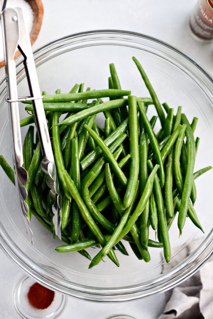 green beans sprayed with olive oil spray and tossed to coat