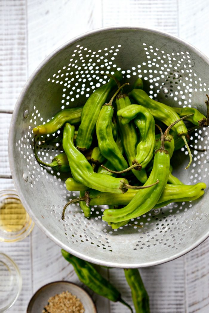 shishito peppers in a colander