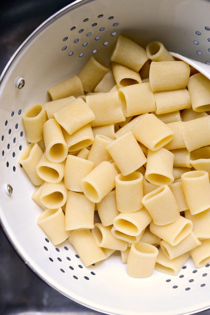 cooked rigatoni in a colander