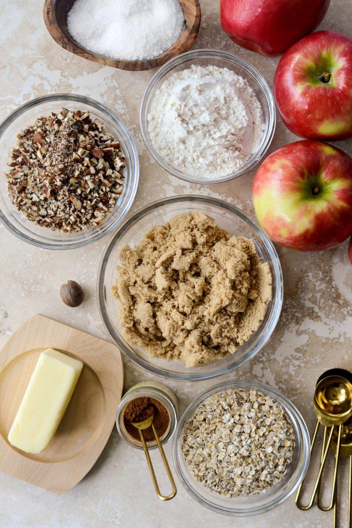 Easy Apple Crisp ingredients; apples, oats, sugar, salt, flour, butter, cinnamon, nutmeg and pecans.