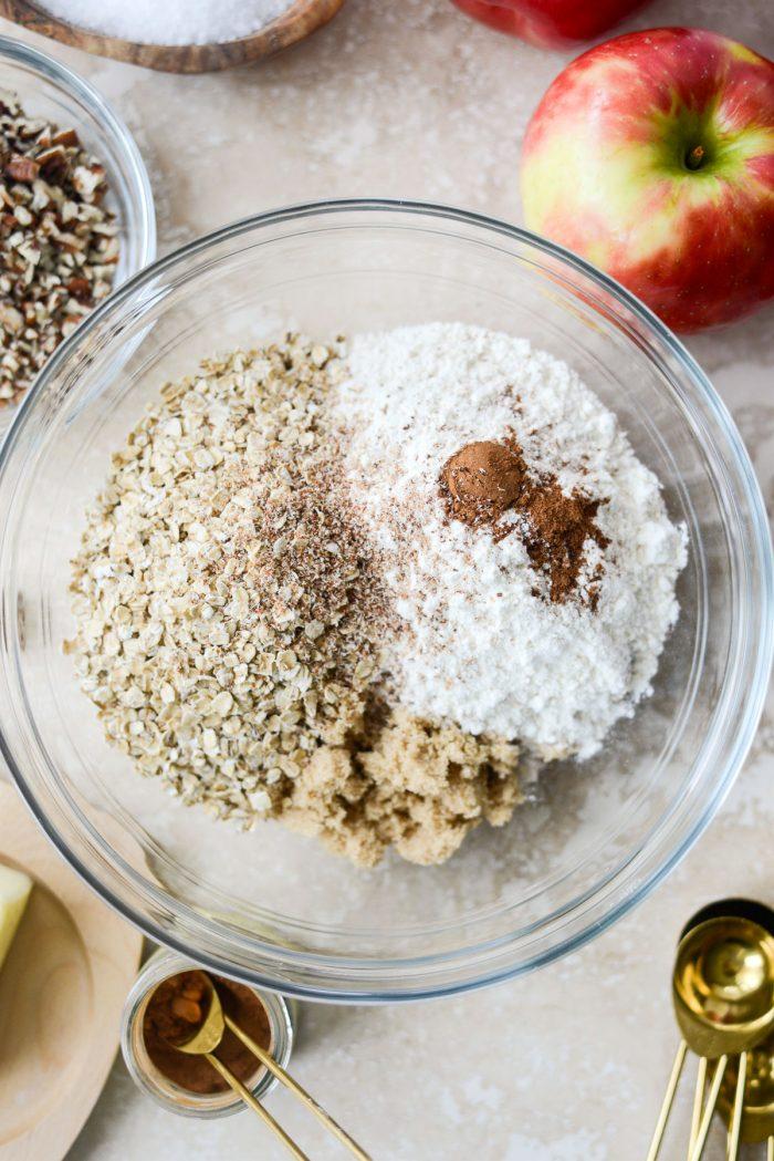 sugar, oats, flour, cinnamon, nutmeg and salt in a glass mixing bowl