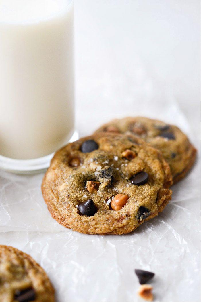 Salted Caramel Espresso Hazelnut Cookies by a glass of milk