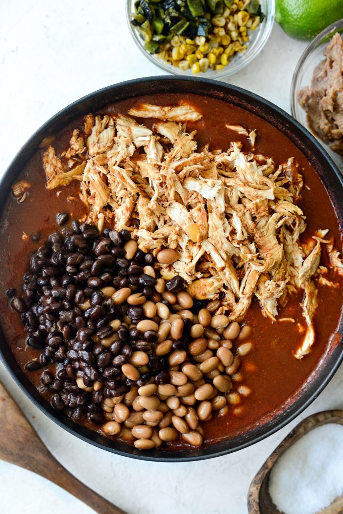 add shredded chicken and beans back to pot