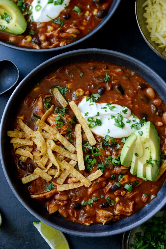 Southwest Chicken Chili with tortilla strips, avocado and cilantro.