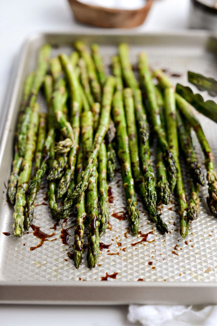 asparagus tossed and coated in balsamic and spices.