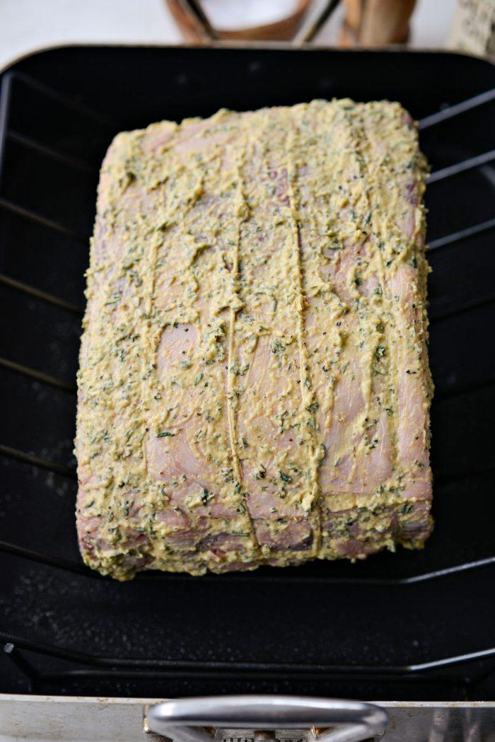 dijon rosemary rib roast on rack in roasting pan.