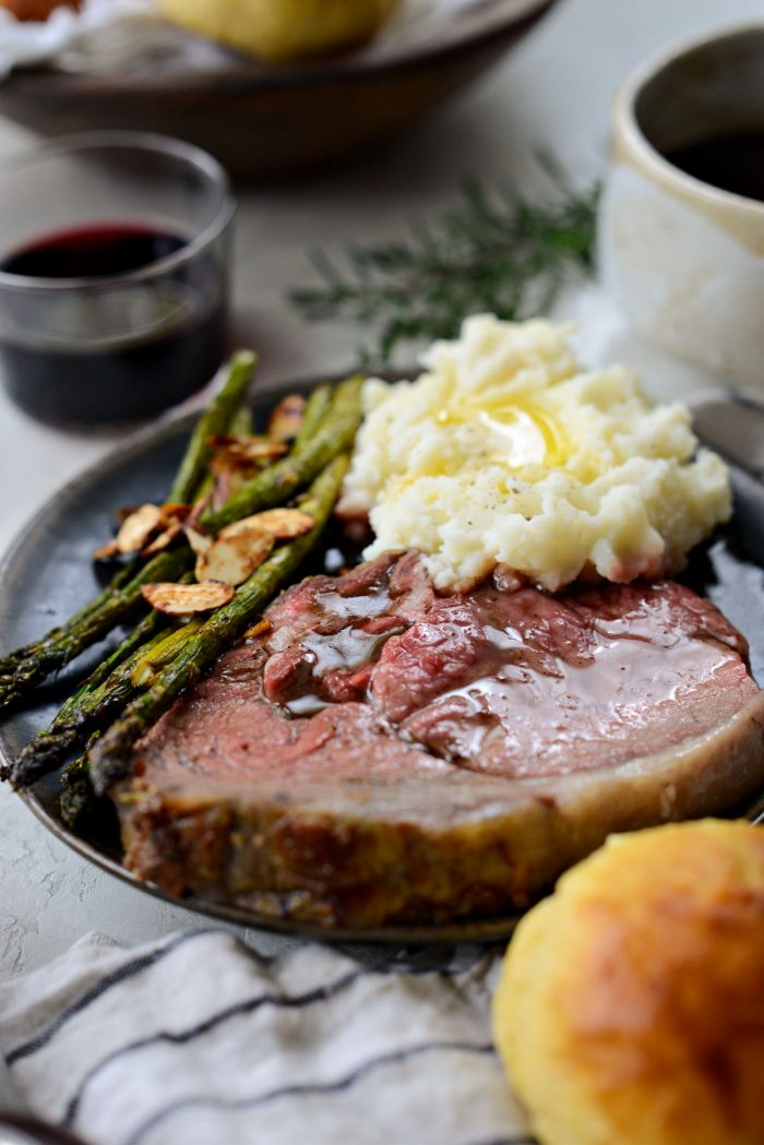 Dijon Rosemary Prime Rib Roast with mashed potatoes and asparagus.