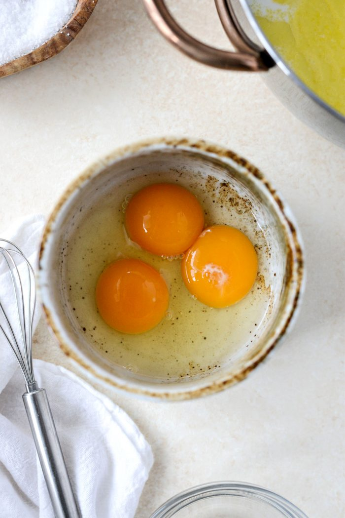 1 egg plus 2 egg yolks in a bowl.
