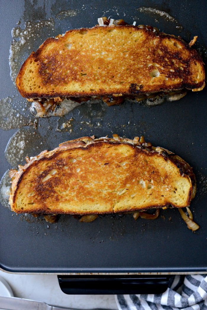golden brown grilled cheese on griddle.