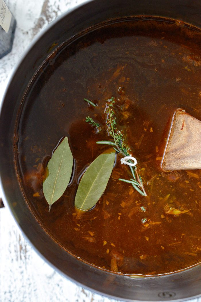 bay leaf and herb bundle added to the soup.