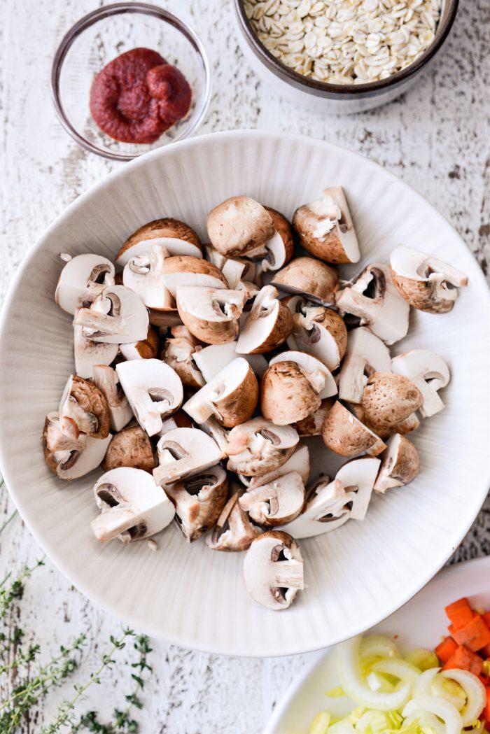 quartered mushrooms in a bowl.