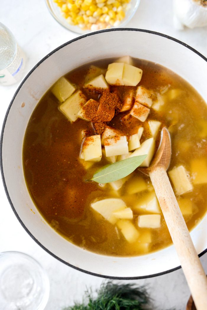 add potatoes, bay leaf and old bay seasoning to soup.