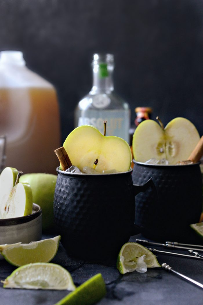 Apple cider Moscow mules in black metal cups.