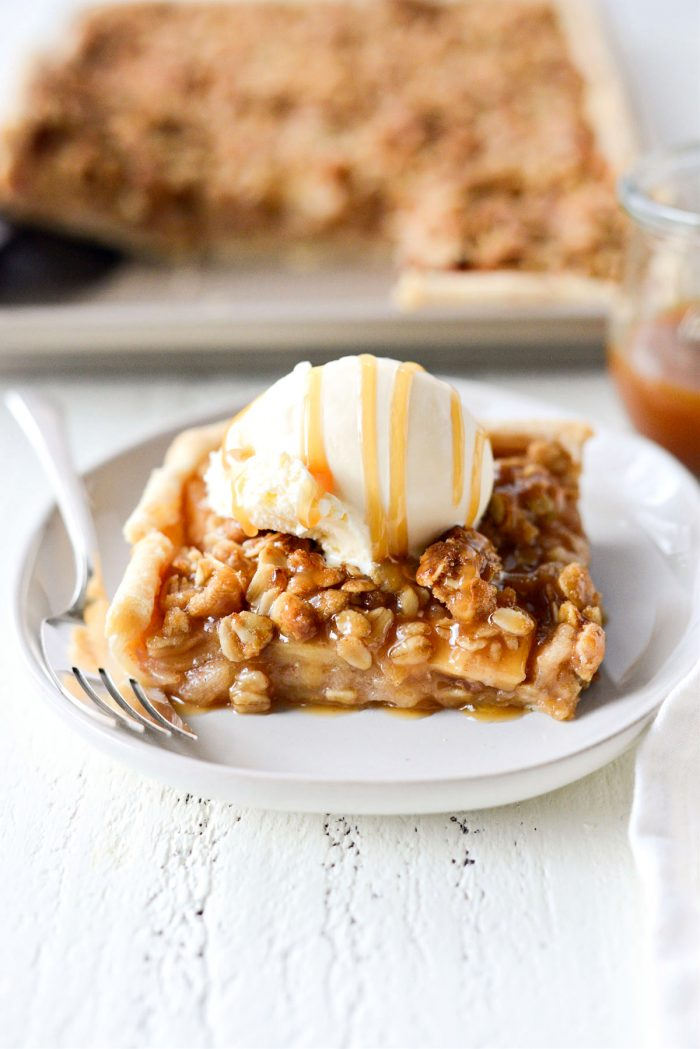 close up of Caramel Apple Slab Pie with ice cream and caramel sauce