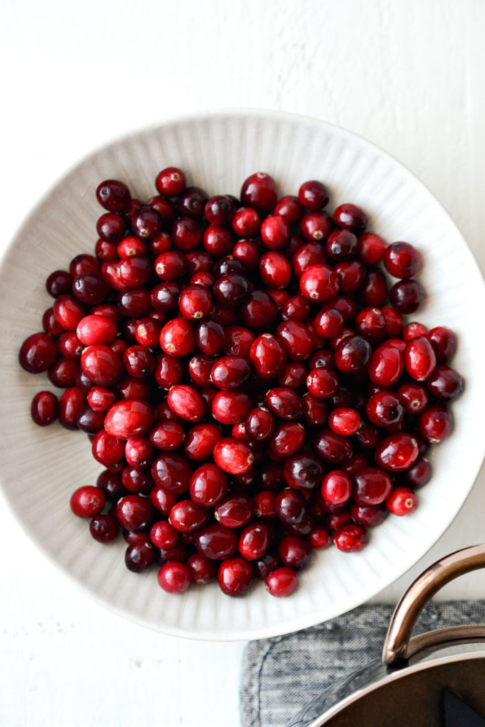 white bowl with cranberries.