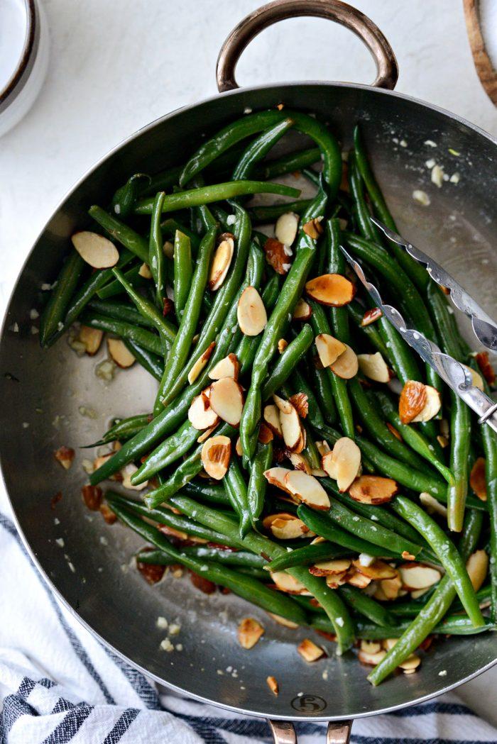 garlicky green beans almondine in skillet.