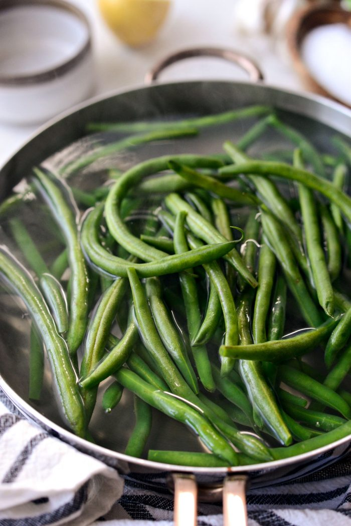 fresh green beans added to boiling water.