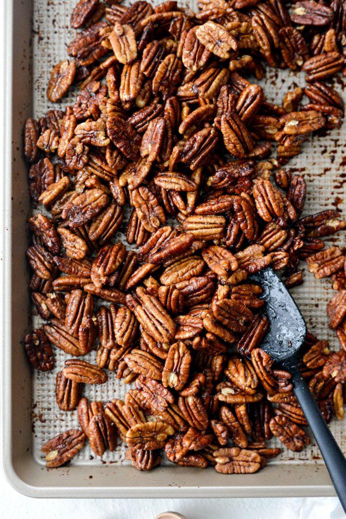 sticky honey vanilla bourbon pecans on sheet pan.