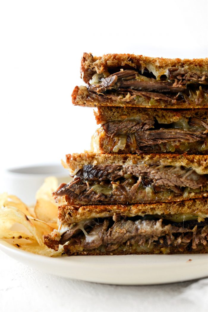 close up of stacked Leftover Pot Roast Cheddar Grilled Cheese Sandwich