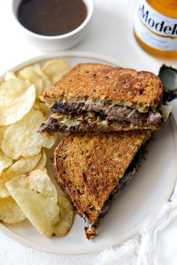 Leftover Pot Roast Cheddar Grilled Cheese Sandwich on a plate with kettle chips.