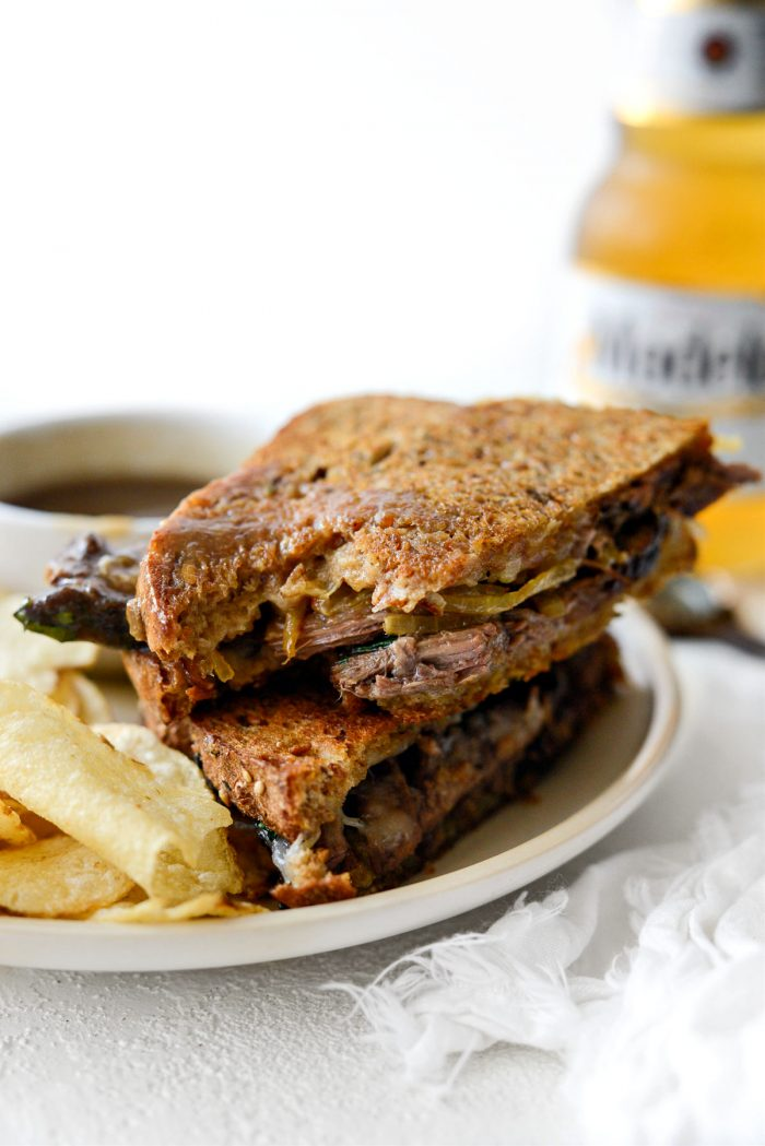 bite missing from Leftover Pot Roast Cheddar Grilled Cheese Sandwich