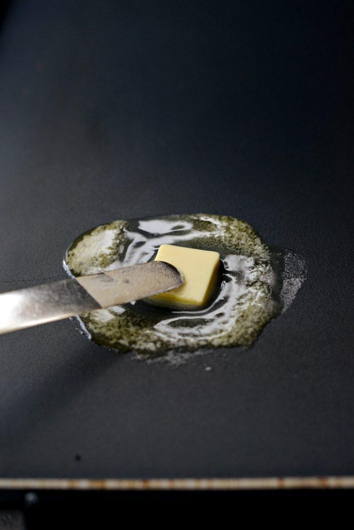 melting butter on a griddle.
