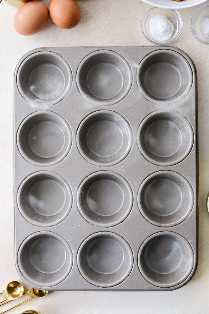 greased muffin tin