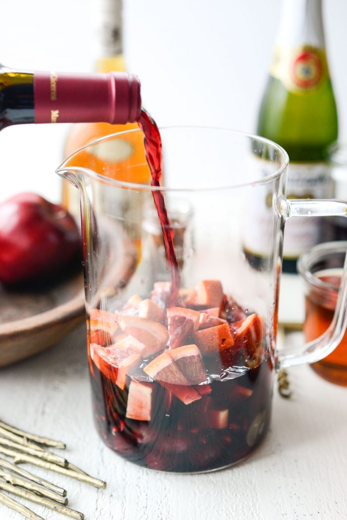 pouring wine into pitcher