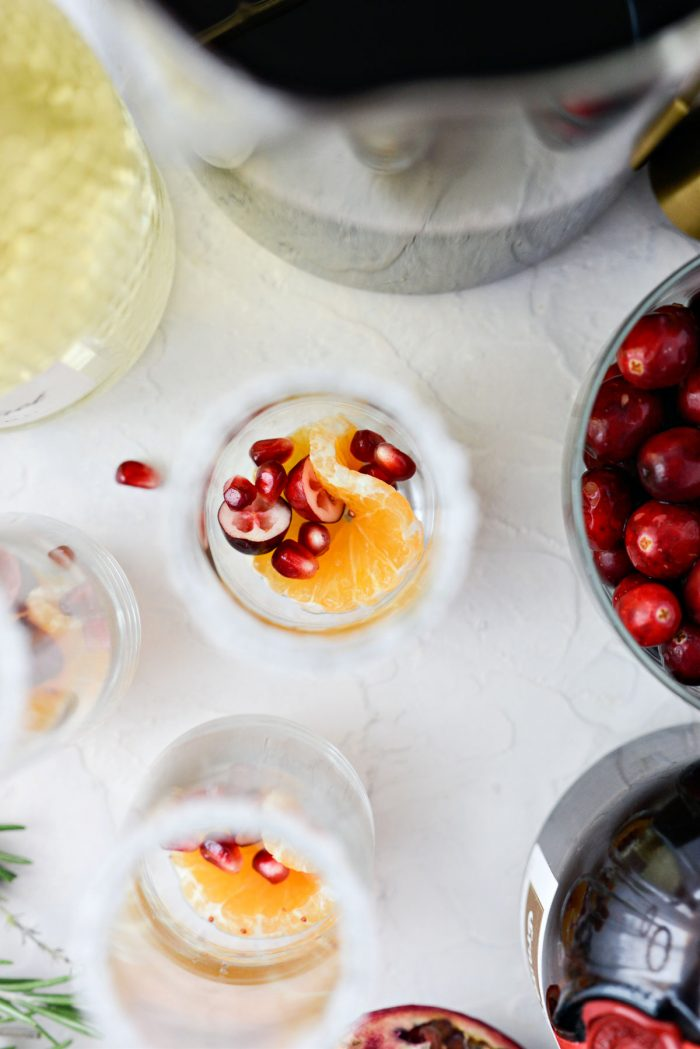 glass with clementine, cranberry and pomegranate arils