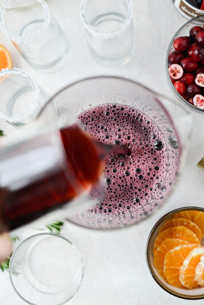 pour pomegranate juice into pitcher.