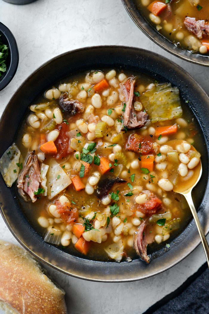 Rustic Ham and Bean Soup in black and gold bowl.