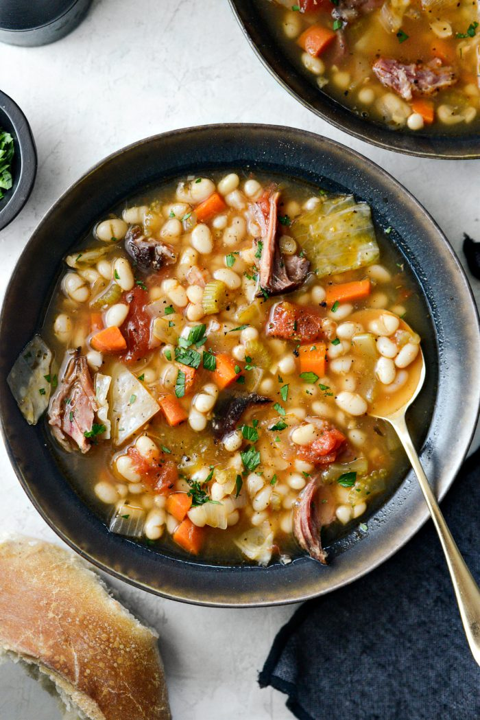 Rustic Ham and Bean Soup with minced parsley.