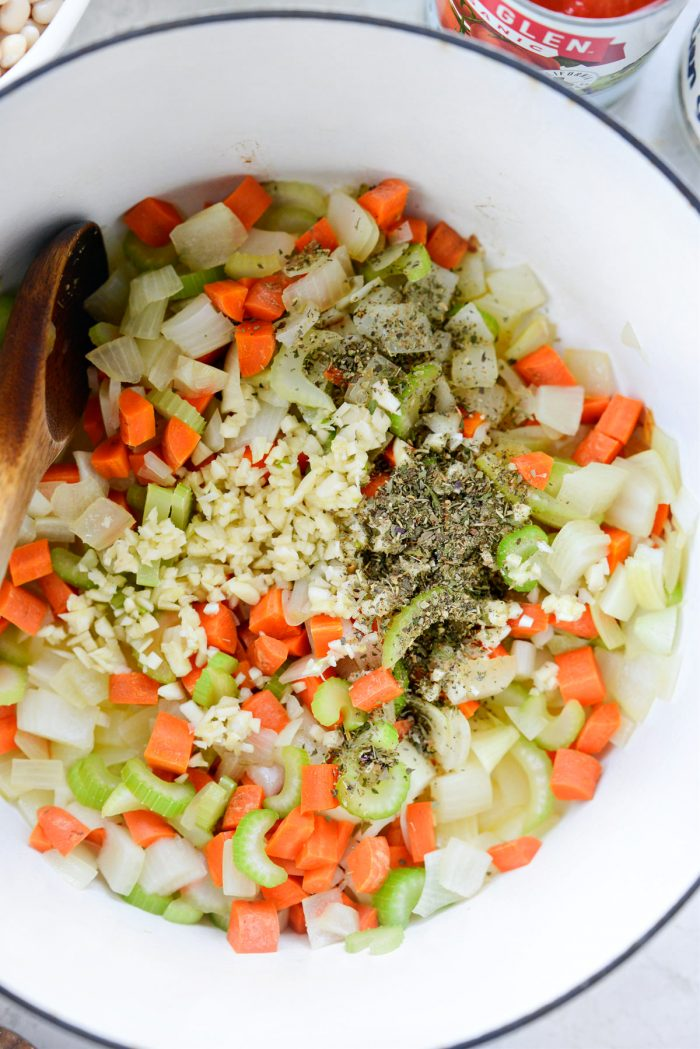 garlic, dried herbs and salt added to vegetables.