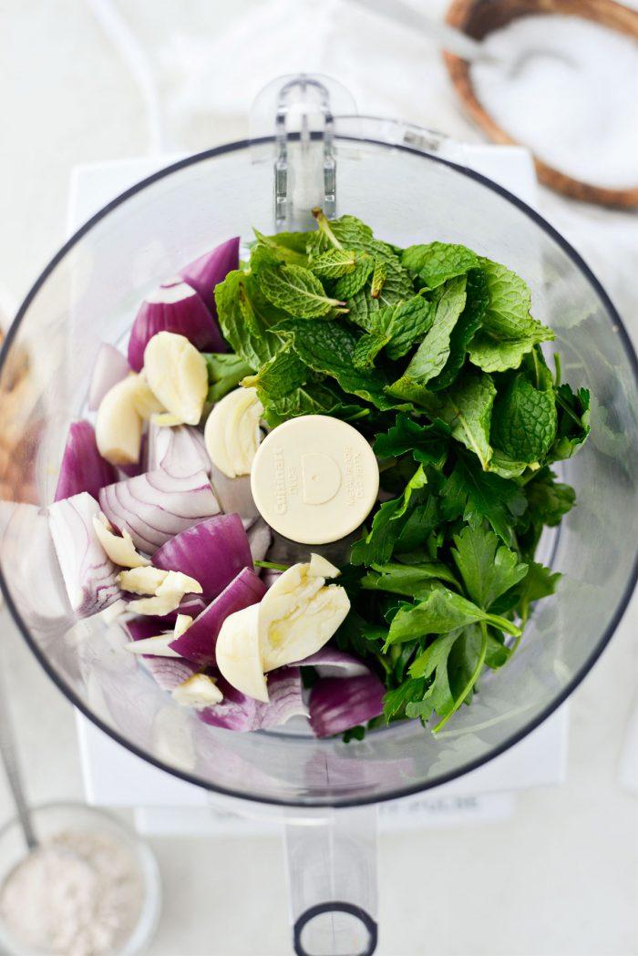 parsley mint, onion, garlic in food processor.