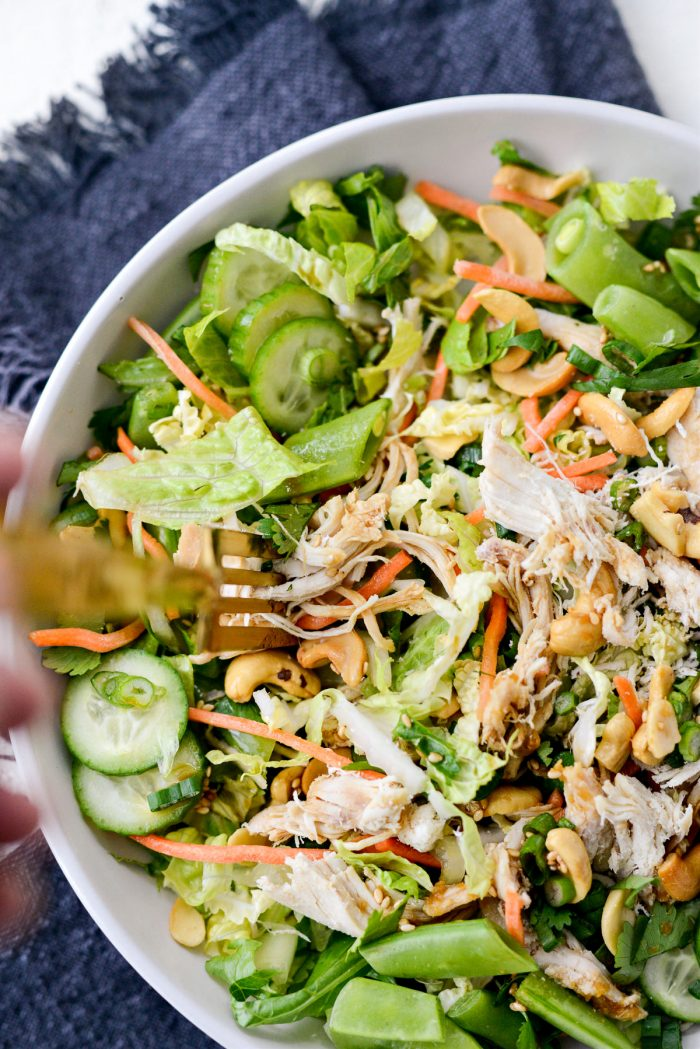 Asian Cashew Chicken Mason Jar Salad in a bowl with gold fork.