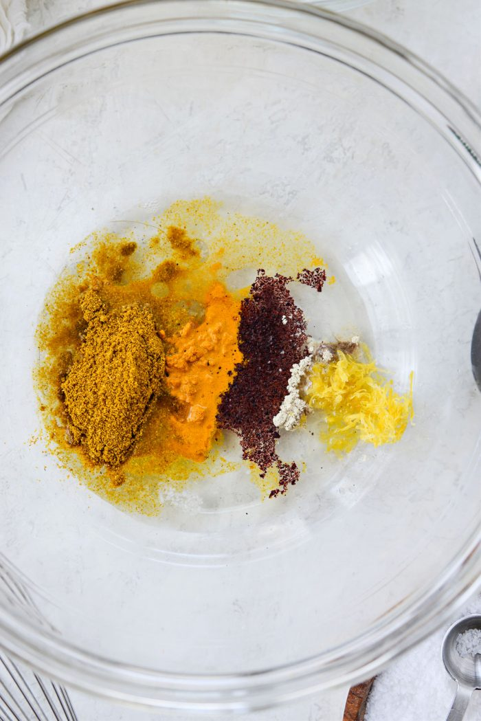Spices with olive oil, lemon juice and zest.
